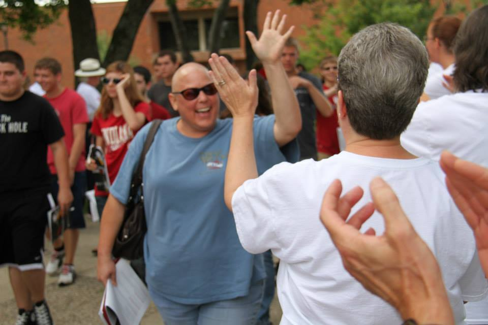 New students are greeted with high-fives.