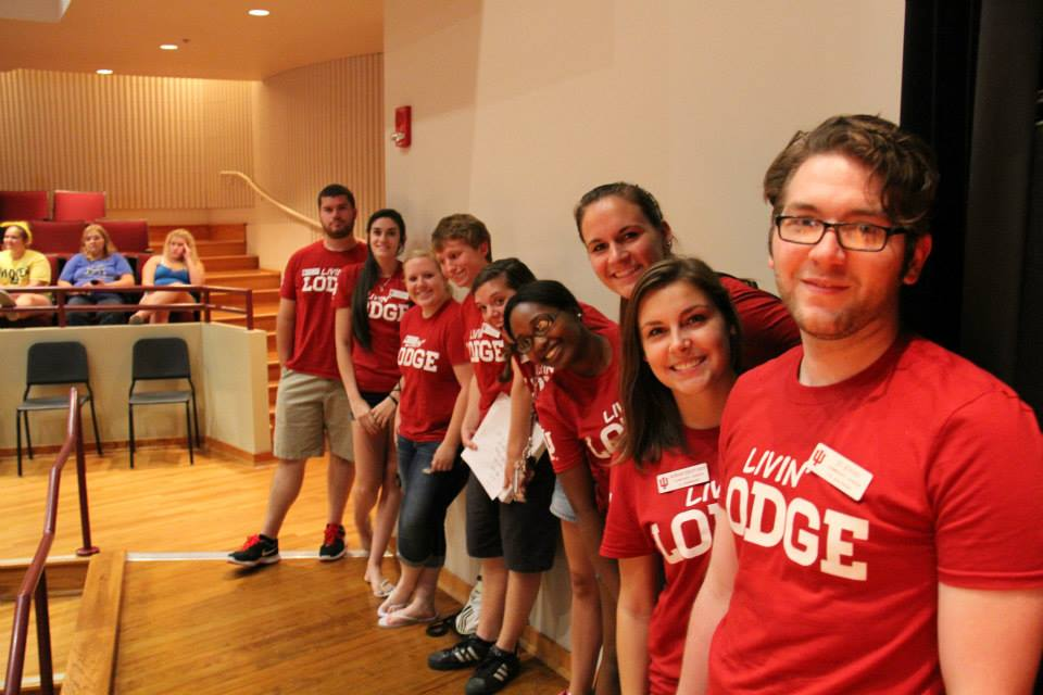 Members of the Crimson Crew gather at the all-housing meeting on move-in day.