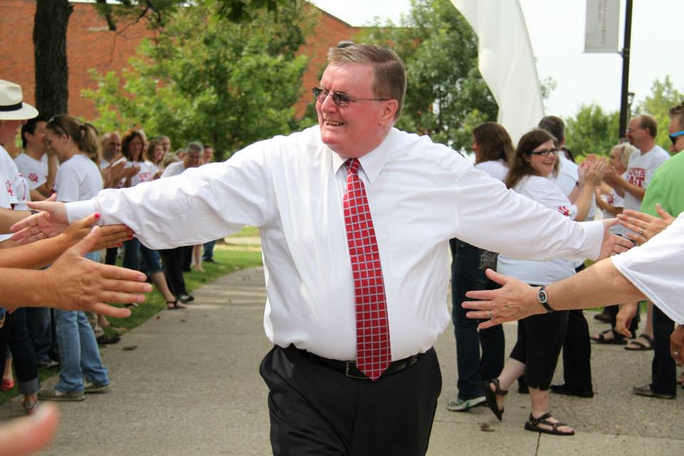 Chancellor Wallace high-fives faculty and staff.