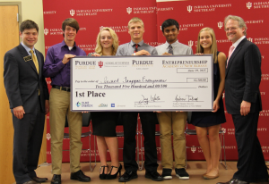 "The winning team, ""Insect Trapper Enterprises,"" with School of Business Dean Jay White and Purdue College of Technology at New Albany Director Andrew Takami."