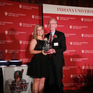 Summer Sanders accepts her award from Jim Morris. Sanders, a native of North Vernon, Ind., was a four-year starter and two-year captain for the Grenadiers. She helped lead the Grenadiers to four-straight KIAC regular-season championships and three-straight KIAC tournament championships from 2012-14. She was also a part of the first Grenadier softball team to advance to the NAIA Elite Eight in 2012. Sanders ranks No. 6 in career games played with 150. Her six career home runs are tied for No. 8 in school history. She is No. 8 in school history in both runs scored with 74 and RBI with 71. She ranks No. 10 in career at-bats with 311. Sanders was a 2014 NAIA Scholar Athlete and has earned recognition on the Athletic Director's Honor Roll with a GPA of 3.0 in every semester of her collegiate career. She was on the Dean's List four times. This season, she hit a walkoff grand slam against conference rival Asbury to end the first game of the doubleheader. In the second game of the day, she suffered a career-ending knee injury while attempting to catch a foul ball. Though her playing career had ended, she continued to lead the team and helped them win their fourth-straight KIAC regular season title during her career. She is majoring in Communications with a concentration in advertising.