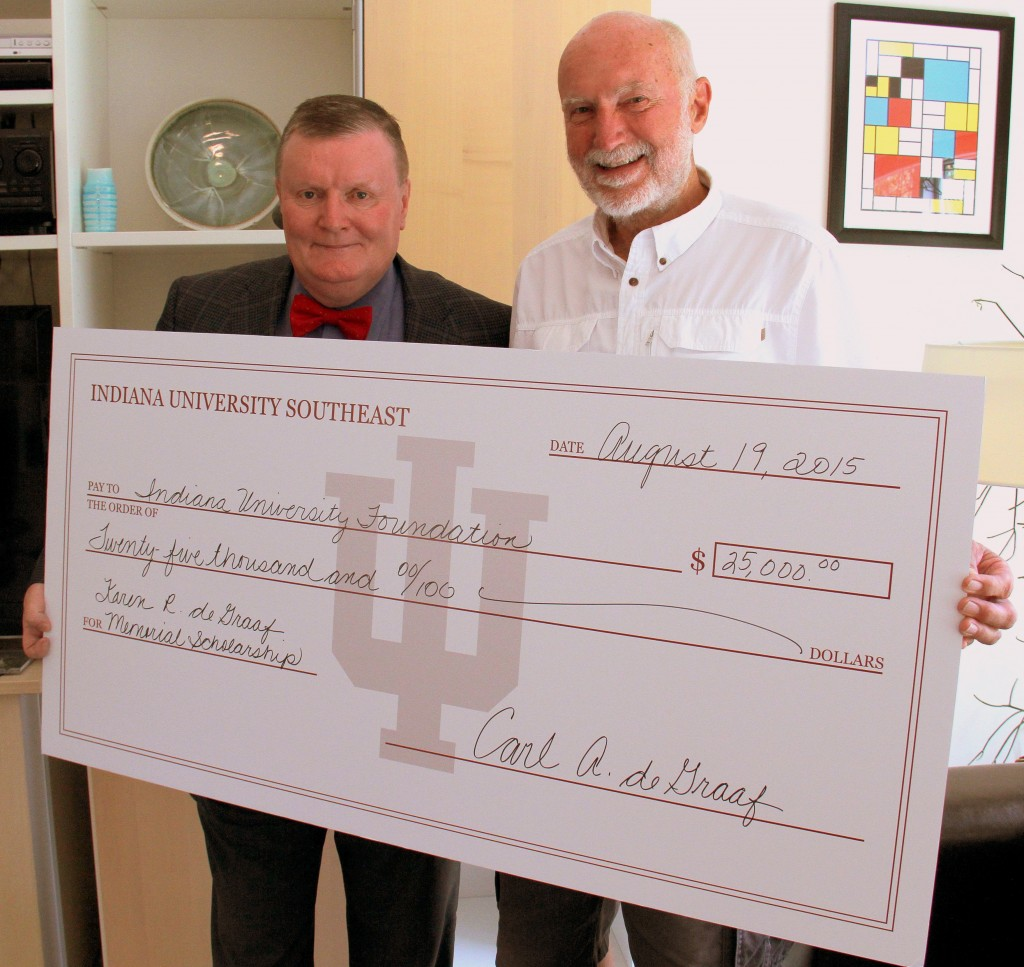Former IU Southeast professor of educational psychology Carl deGraaf presents a check to Chancellor Ray Wallace for the Karen R. deGraaf Memorial Scholarship.