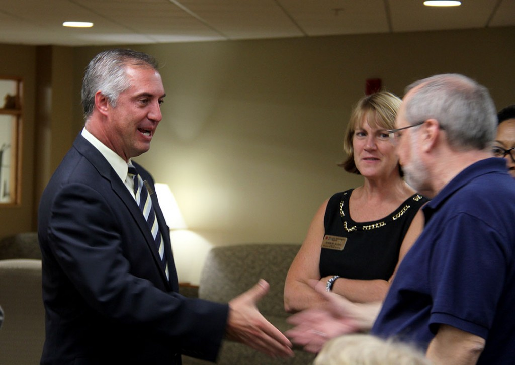 J.T. Thomas (left) greets members of the IU Southeast faculty and staff.