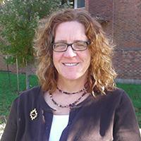 Interdisciplinary studies director leads international organization