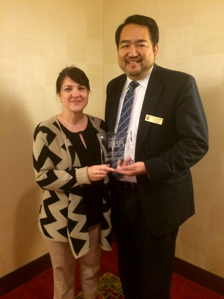 Seuth Chaleunphonh, dean of student life, receives the Dean Richard McKaig 2015 Award for Exemplary Leadership in Addressing High Risk Drinking from Lisa Hutcheson, director of the Indiana Coalition to Reduce Underage Drinking.