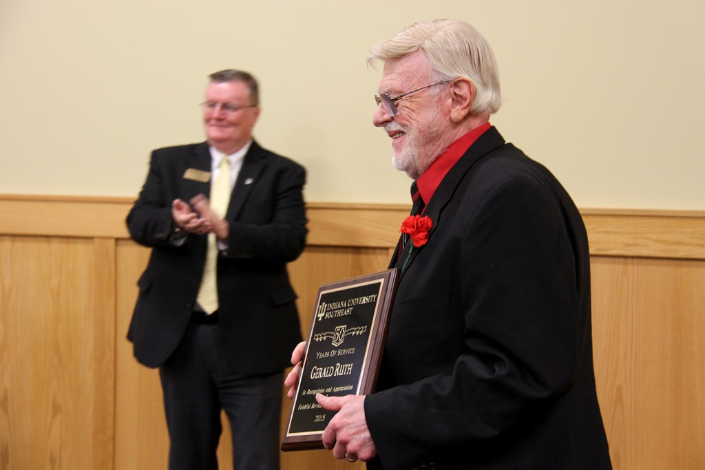 Dr. Gerald Ruth (right) smiles as he receives applause for 50 years of service to IU Southeast.
