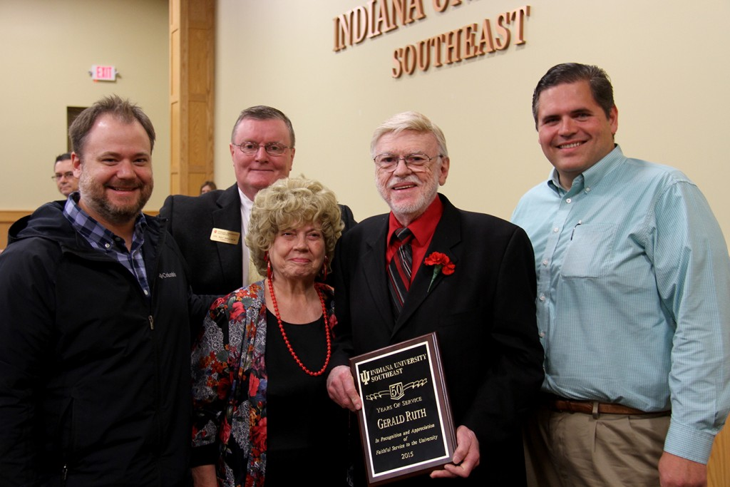 Dr. Gerald Ruth (center) celebrates 50 years of service to IU Southeast with (from left) son Jonathan Ruth, Chancellor Ray Wallace, wife Ellen Ruth and State Representative Ed Clere.