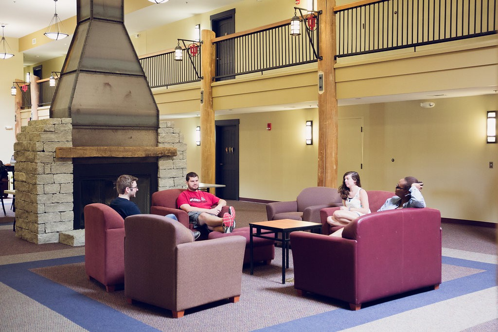 Students lounge in front of the fireplace in one of the IU Southeast residence lodges.