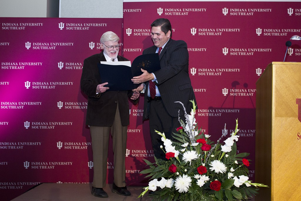 Dr. Gerald Ruth (left) receives the Sagamore of the Wabash award from Rep. Ed Clere during IU Southeast's 75th Anniversary celebration.