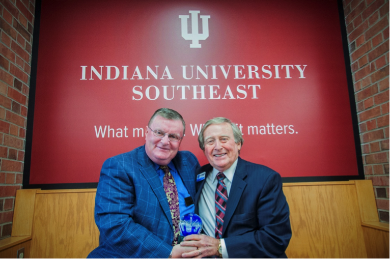 Chancellor Ray Wallace (left) receives a and Bob Kleehamer, senior vice president of River Valley Financial Bank,