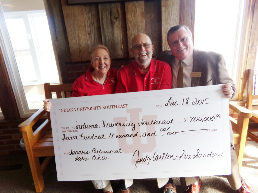 Sue Sanders and Judge Carlton Sanders (left, center) present a check for $700,000 to Chancellor Ray Wallace for the Professional Sales Center.