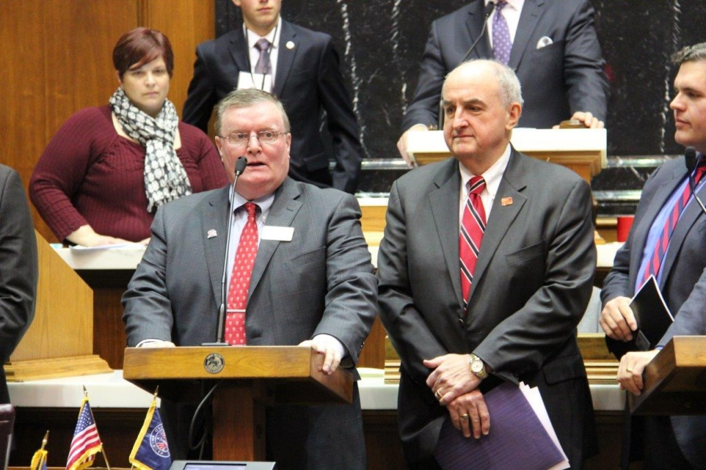 IU Southeast Chancellor Ray Wallace (left) addresses the Indiana House of Representatives with Indiana University President Michael A. McRobbie (right) and Rep. Ed Clere.