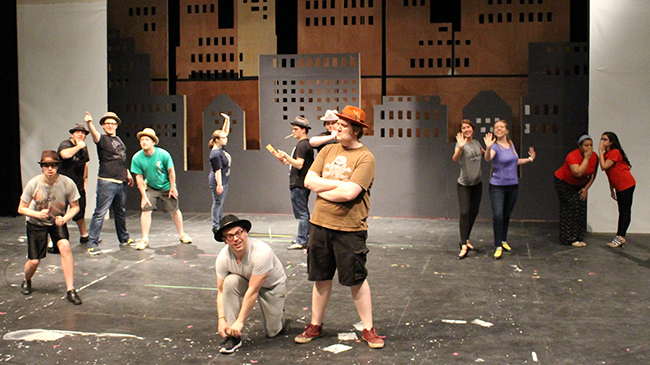 Cast of Guys and Dolls rehearsing