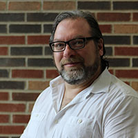 Writing faculty Michael Jackman to read at Louisville writer's forum