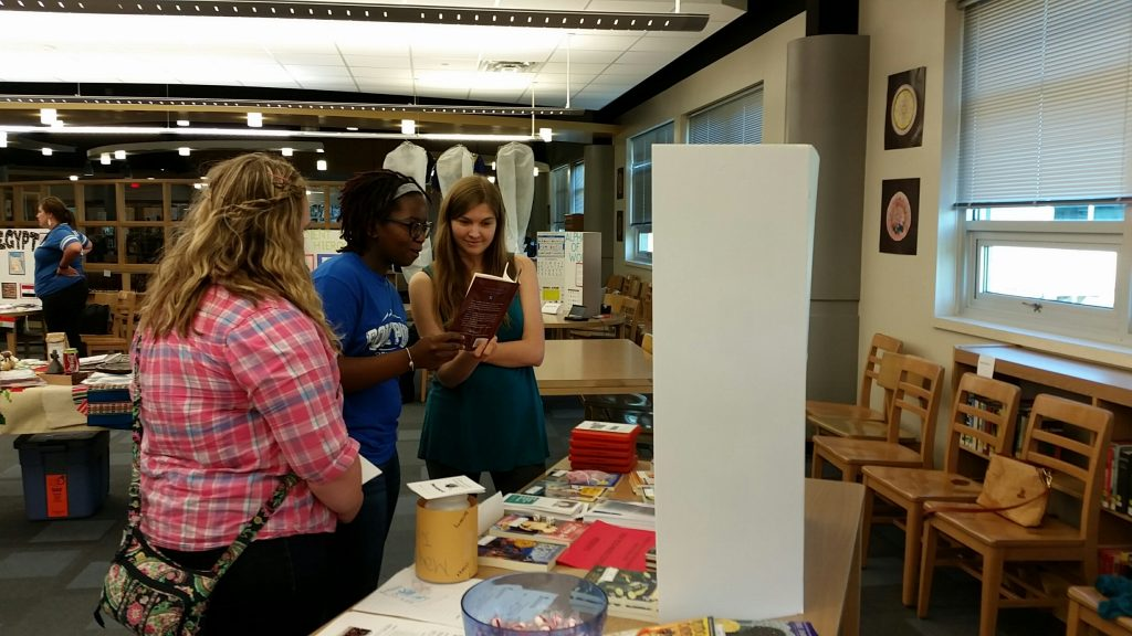 Students examine books from around the world at the World Fest at