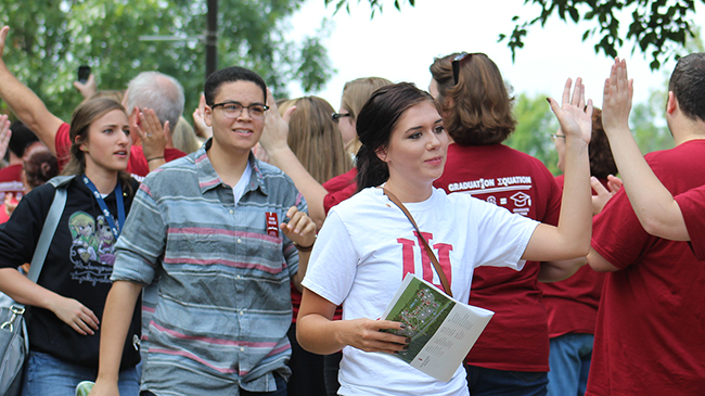 "New students are welcomed by a traditional faculty-staff ""gauntlet"" during Induction Day at IU Southeast."