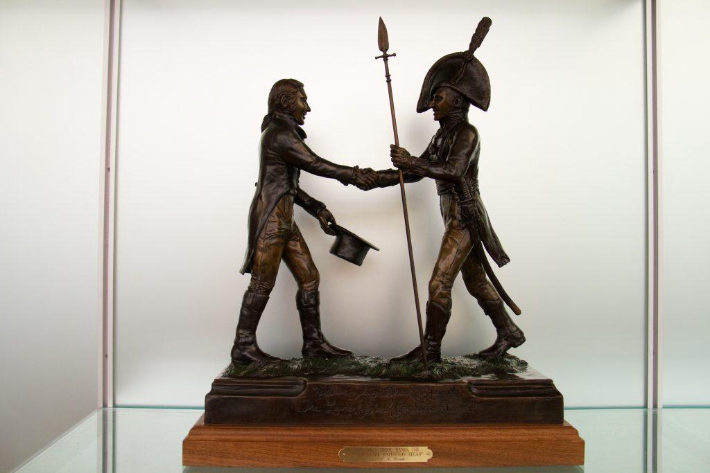 The bronze statue immortalizing the handshake between Meriwether Lewis and William Clark.