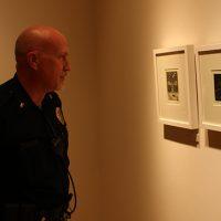 Lt. Stephen Miller looks at prints by Deborah Maris Lader