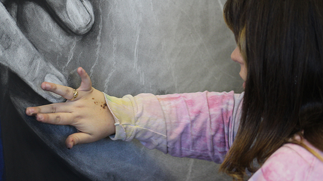 IU Southeast student touches up her drawing