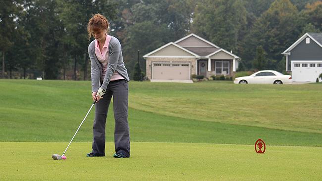 Accounting student Julianne Kramer hits golf ball