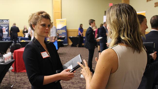 Student Julianne Kramer talks with an employer