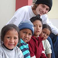 Elijah Brown with Ecuadorian children