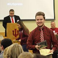 Phillip Steinmetz of Jeffersonville High School accepts a prize