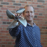 Paul Pittman holding propeller