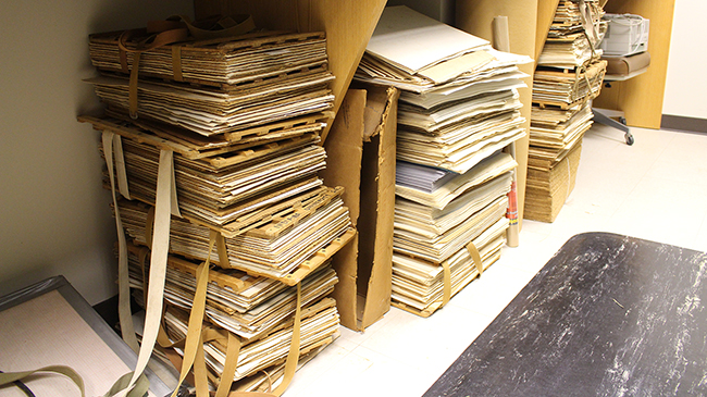 Old style field presses stacked in the herbarium.