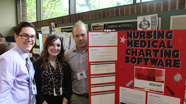 Students present poster.