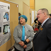 Chancellor Wallace views student pioster