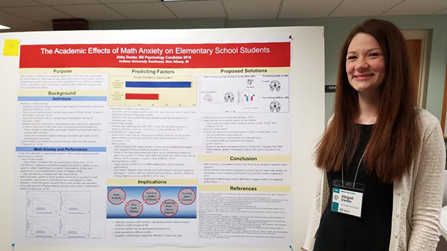 Abigail Dester with poster about math anxiety