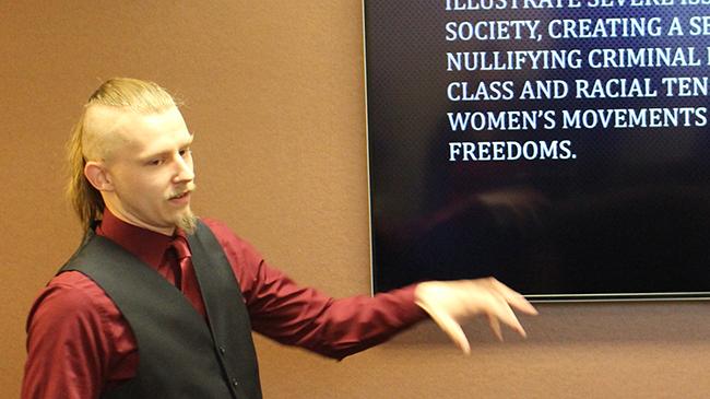Jayce Beavin, history student, explains the world of Jack the Ripper.