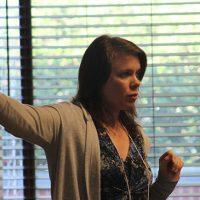 Graduate student Jade Bilyeu explains the impact of the emerald ash borer.