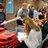 Students line up to register for the conference.