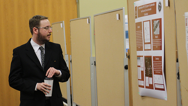 Chemistry student David Glass checks his poster.
