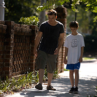 Teacher and boy walking in scene from Finding Home