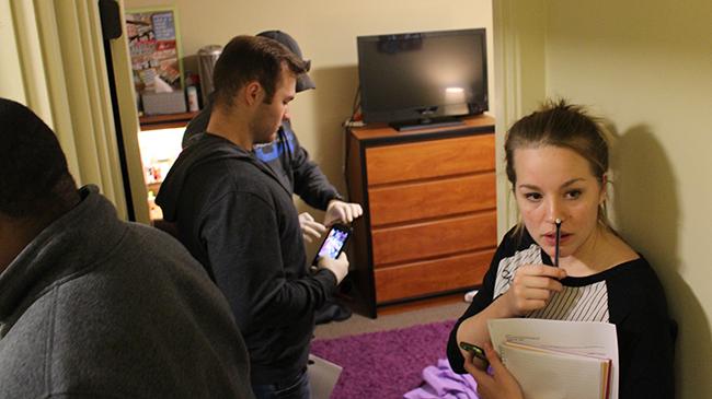 Students analyze a crime scene staged by Bernadette Jessie.