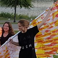 Students dance with phoenix sculpture