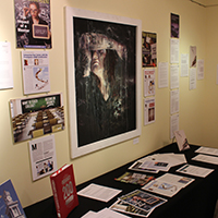 Selection of books, papers, paintings at Artists and Authors show
