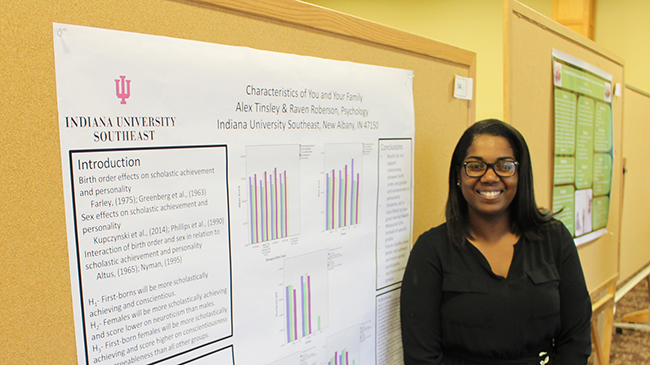 Raven Roberson '17 stands by her research poster at the 2017 Undergraduate Research Conference.