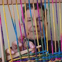 Dr. Anne Allen weaving on Navajo loom.