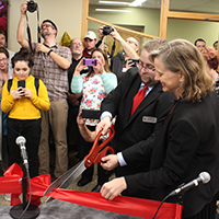 Assistant Professor Adam Maksl and School of Social Sciences Dean Kelly Ryan cut ribbon to launch Horizon Radio.