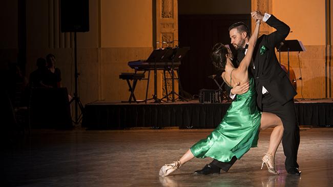 A couple dances the tango.