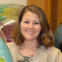 Jennifer Lathem with globes in her classroom.