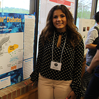 Student with poster on the subject of diabetes.
