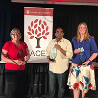Lisa Russell, Sridhar Ramachandran and Rhonda Wrzenski pose with their Academy Awards from FACET.