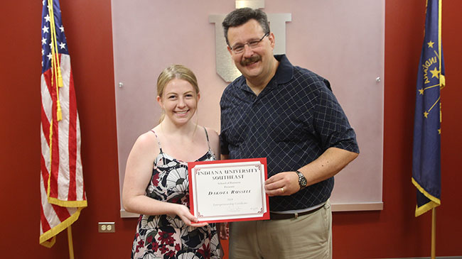 Dakota Russell (l) accepts the certificate in entrepreneurship from Dean of the School of Business David Eplion.