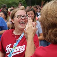 Incoming student gets high-five from member of IU Southeast faculty.