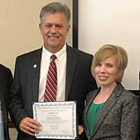 Lisa Book and Jeff Byrne win honors from MidAmerican Business Deans Association